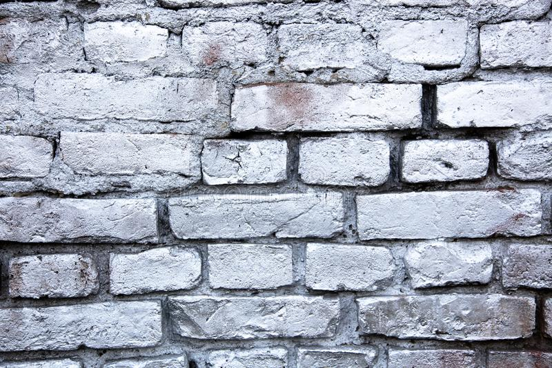 Simple white and grey brick wall painted with metallic sprayed ink texture background. Simple white and grey brick wall painted with metallic sprayed ink paint stock photo