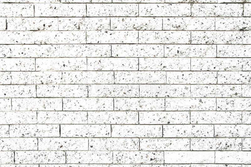 Simple white and grey rectangular stone brick wall as seamless pattern surface texture background.  stock photography
