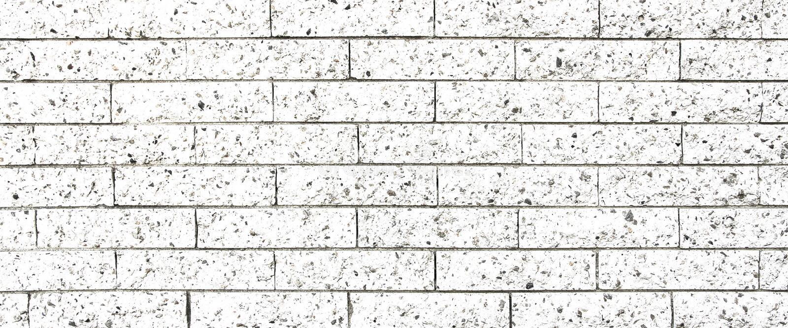 Simple white and grey rectangular stone brick wall as seamless pattern surface texture background in wide panorama banner format.  stock photos