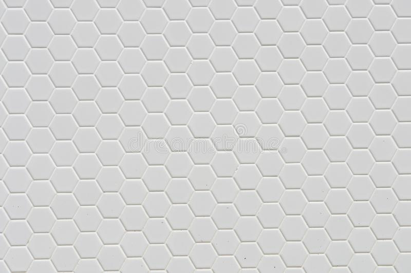A simple white texture pattern. Of hexagons as a background stock images