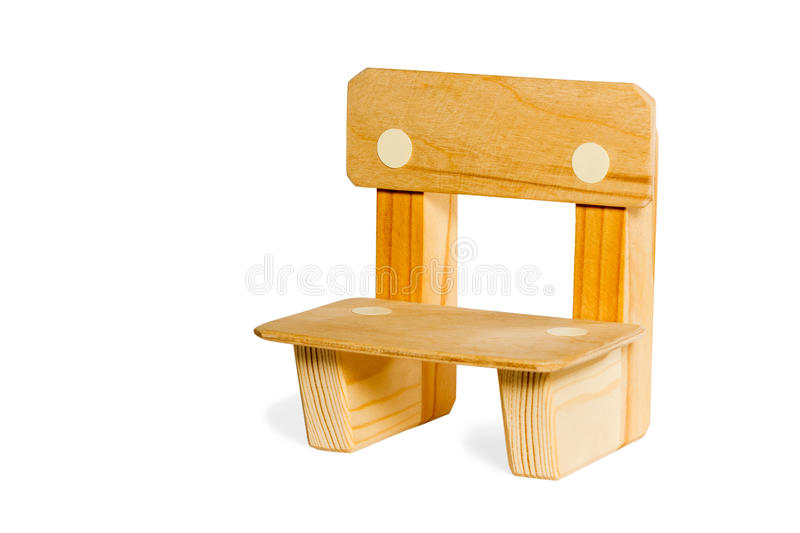 Simple wooden kid chair. Little children with continuous legs wooden chair isolated on white background royalty free stock image