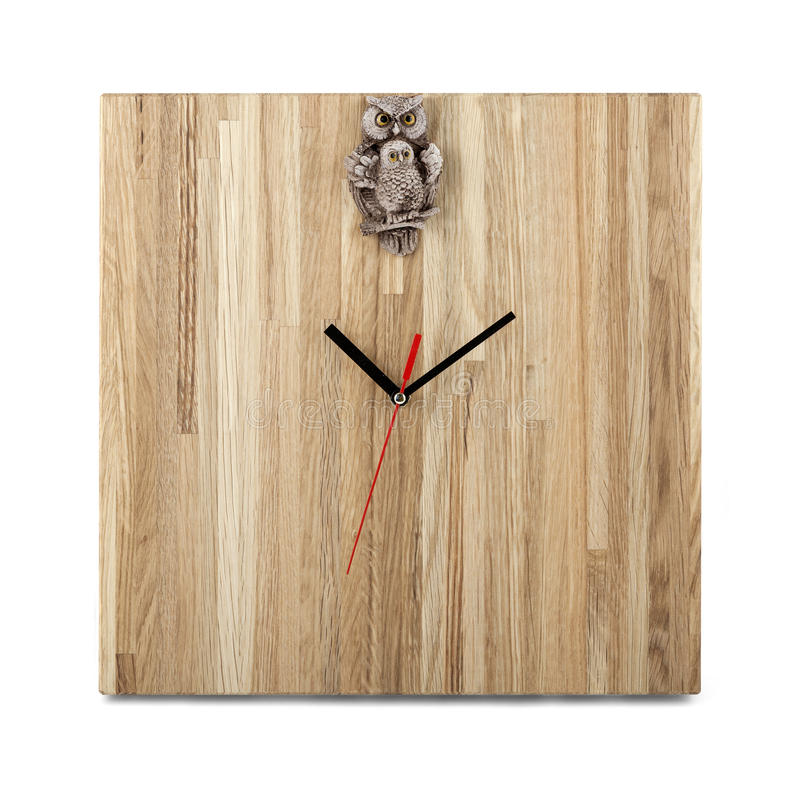 Simple wooden wall watch with owl - Square clock isolated stock images