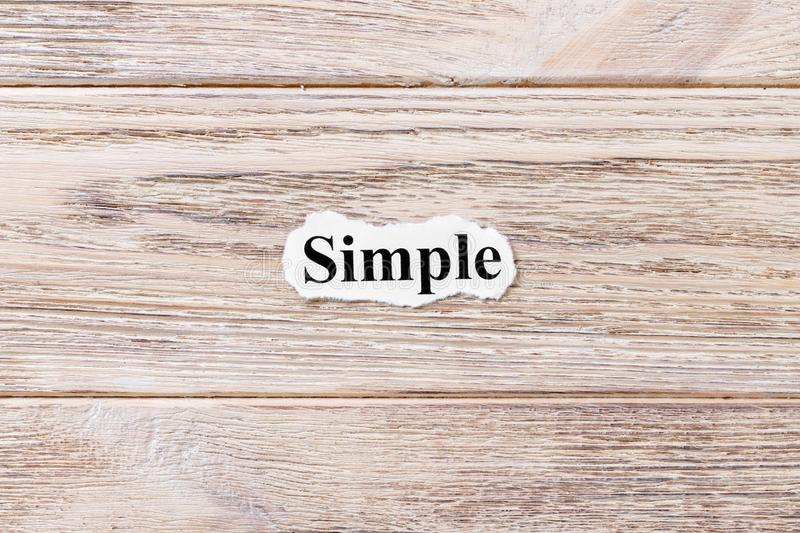 Simple of the word on paper. concept. Words of Simple on a wooden background.  royalty free stock images
