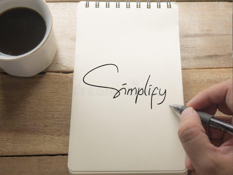 Simplifique, concepto de motivación de las citas de las palabras del negocio fotografía de archivo libre de regalías
