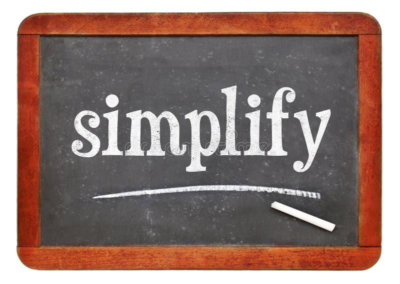 Simplifique la palabra en la pizarra imagen de archivo libre de regalías
