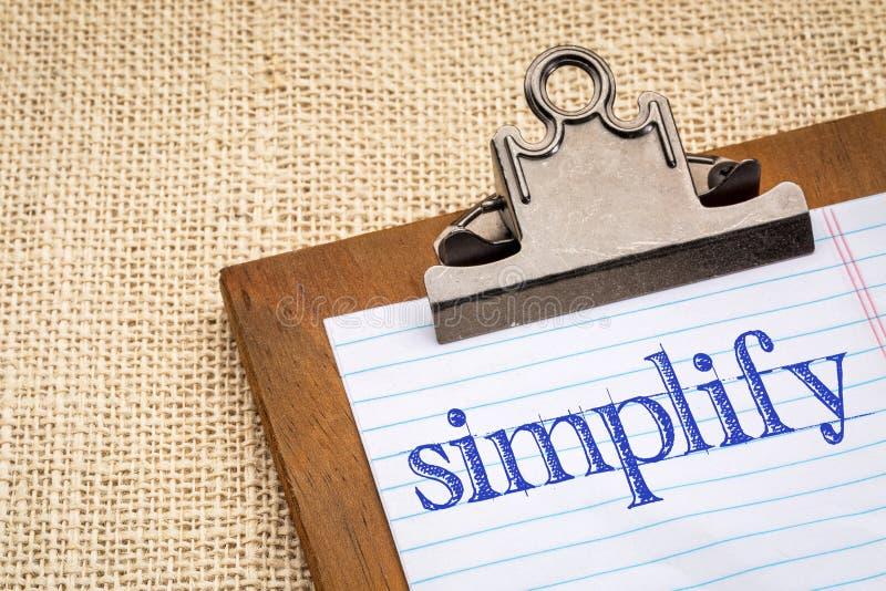 Simplifique la palabra en un tablero fotos de archivo
