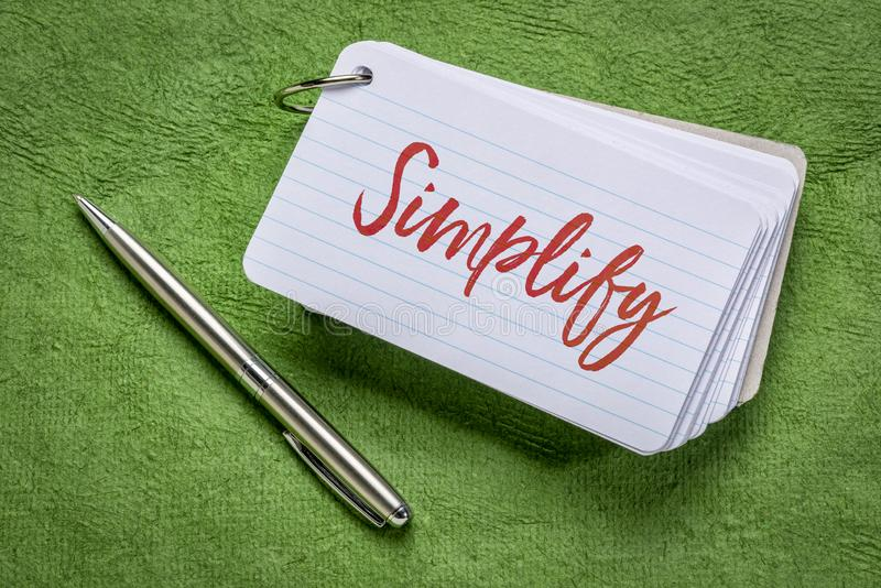 Simplifique a palavra em um cartão de índice ilustração stock
