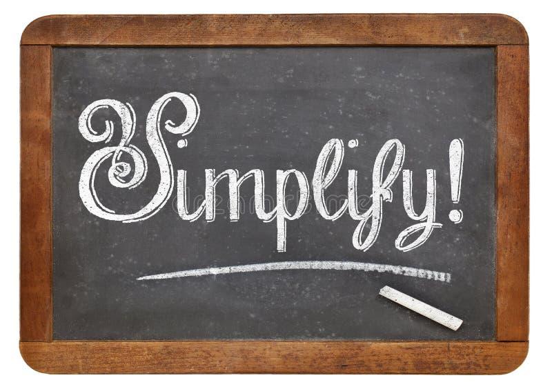 Simplifique a palavra no quadro-negro fotografia de stock royalty free