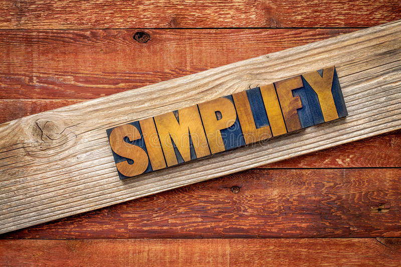 Simplify word - rustic sign stock image