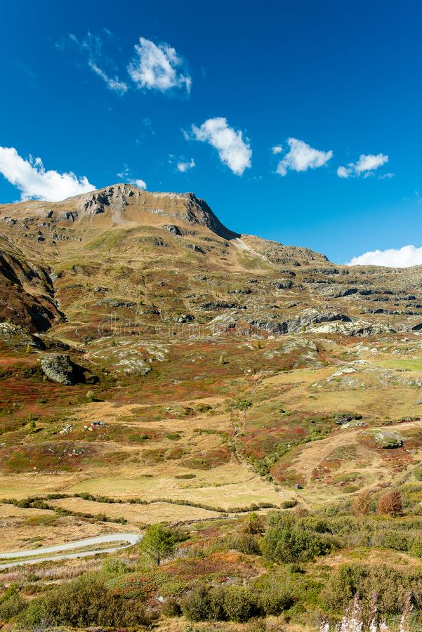 Simplon pass, alpine landscape of a mountain pass with church an royalty free stock photography