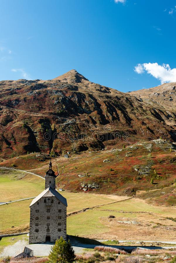 Simplon pass, alpine landscape of a mountain pass with church an stock photography