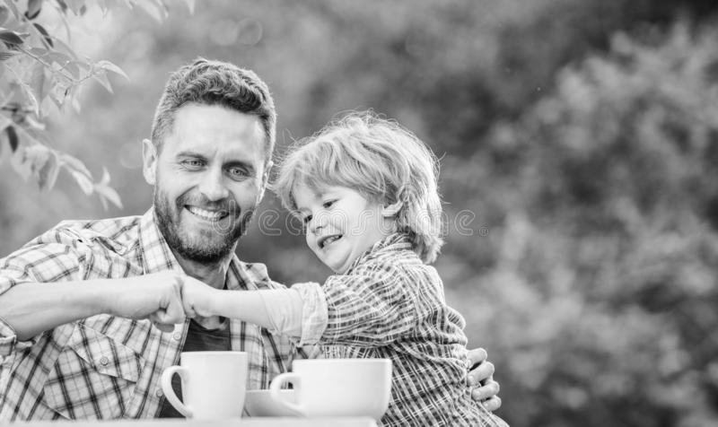 Simply being around. organic and natural food. small boy child with dad. healthy food. Family day bonding. they love stock image