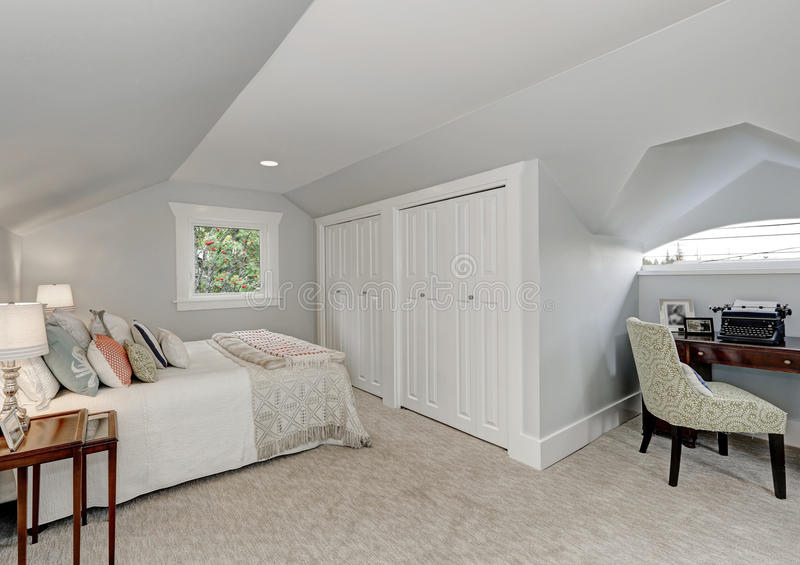 Simply furnished Attic bedroom interior stock image