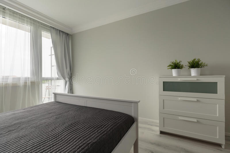 Simply modern bedroom furniture stock photos