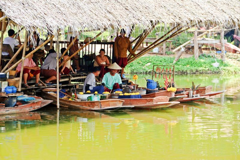 Simulate Thai ancient lifestyle. Karnchana buri, Thailand: January 20, 2019: Life nearby the river. Simulating the ancient Thai lifestyle at Mallika city, 1905 A stock photo