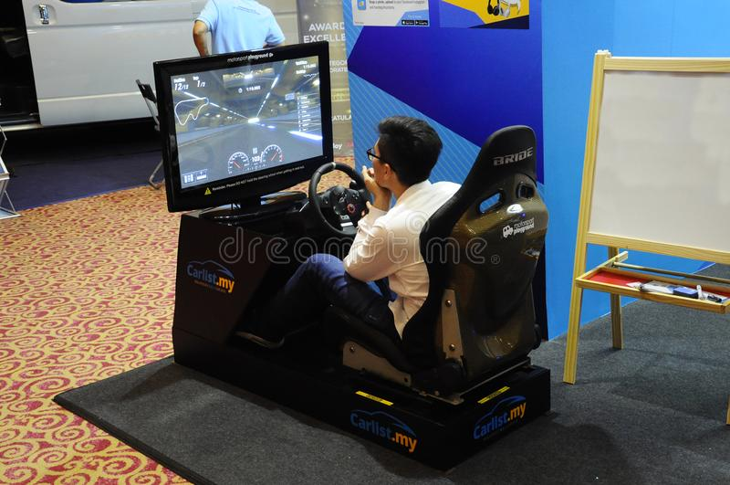Simulation of race car video player game with big screen monitors and cockpit controls like a racing car. royalty free stock images