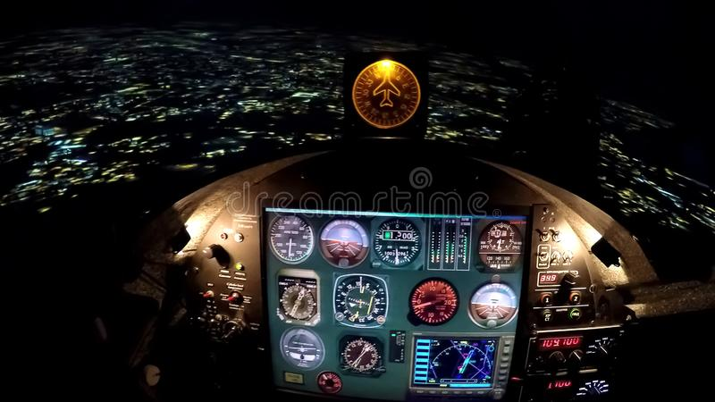 Simulator control panel of flight above night city, airplane steering wheel stock photo