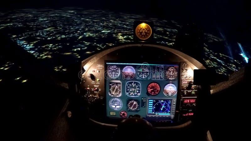 Simulator of night flight above city, training equipment for beginner pilots royalty free stock photography