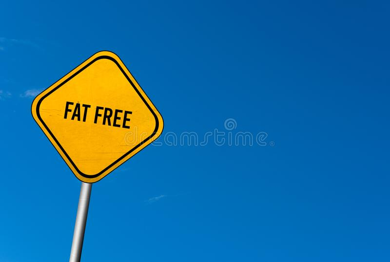 sin grasa - muestra amarilla con el cielo azul imágenes de archivo libres de regalías