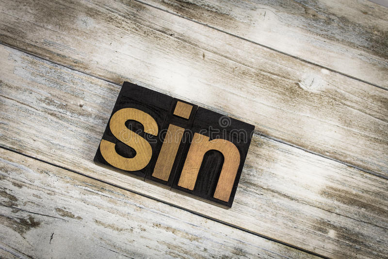 Sin Letterpress Word on Wooden Background royalty free stock photos