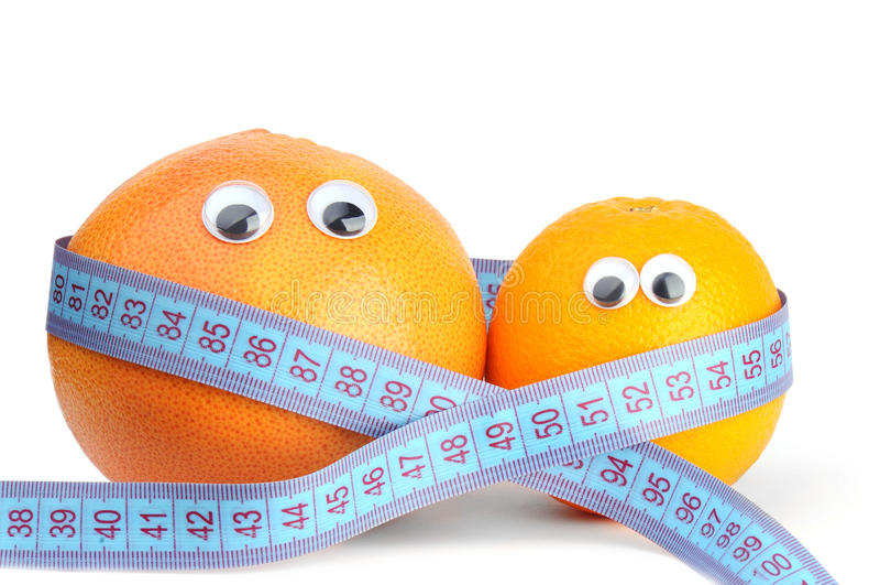 Sinaasappel en grapefruit in meting stock afbeelding