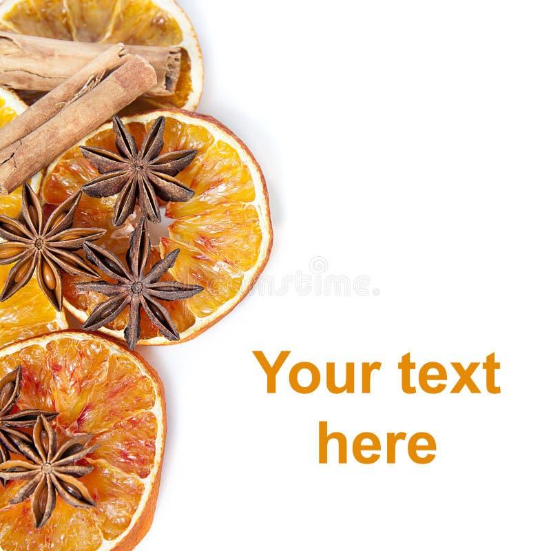 Sinaasappel en kruidenachtergrond stock foto's