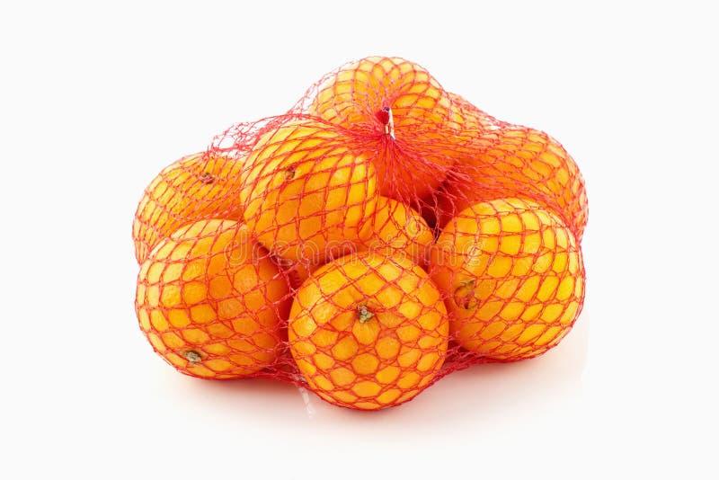 Sinaasappelen in een net royalty-vrije stock foto