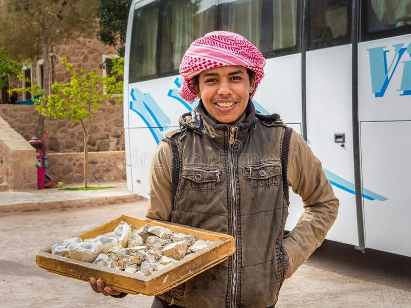 Sinai / Egypt - 03/25/2016: A young bedouin sells souvenirs at the foot of Mount Sinai on the territory of St. Catherine's royalty free stock images