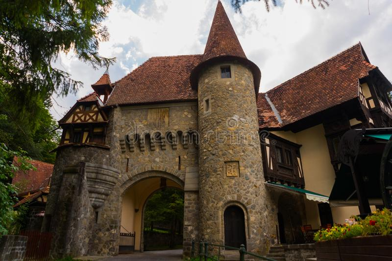 SINAIA, ROMANIA: Beautiful old gate. Buildings near the Pelesh Castle in Sinaia, Romania royalty free stock photo