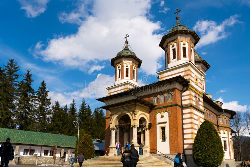 Sinaia, Romania - March 09, 2019: People visiting Sinaia Monastery located in Sinaia, Prahova county, Romania.  stock images