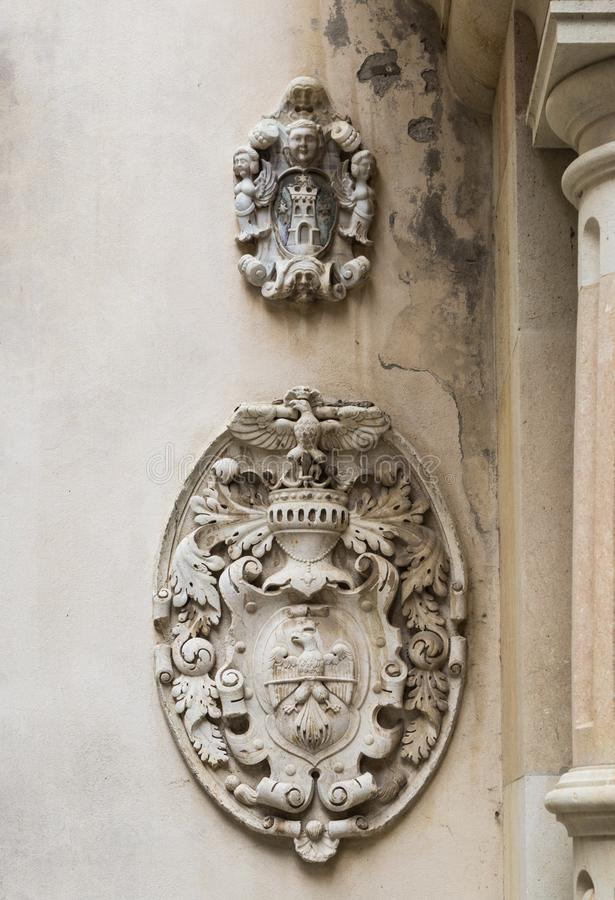 Coats of arms on the wall in the courtyard of the Peles castle in Sinaia, in Romania stock image