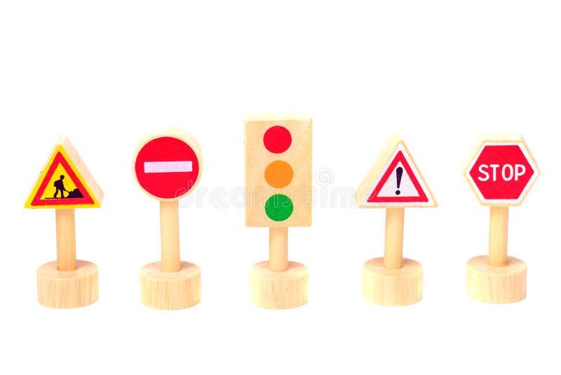 Sinais de estrada isolados no fundo branco Toy Traffic foto de stock royalty free