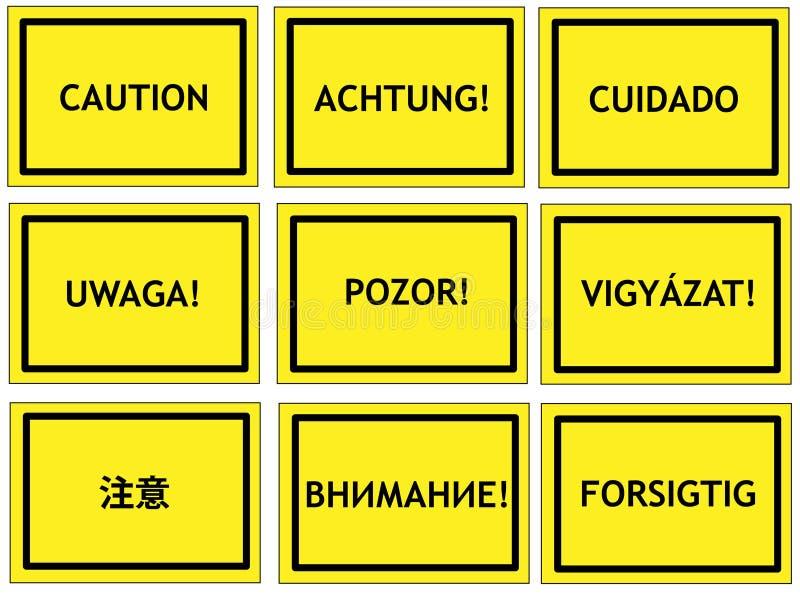 Sinais multilingues do cuidado fotografia de stock royalty free