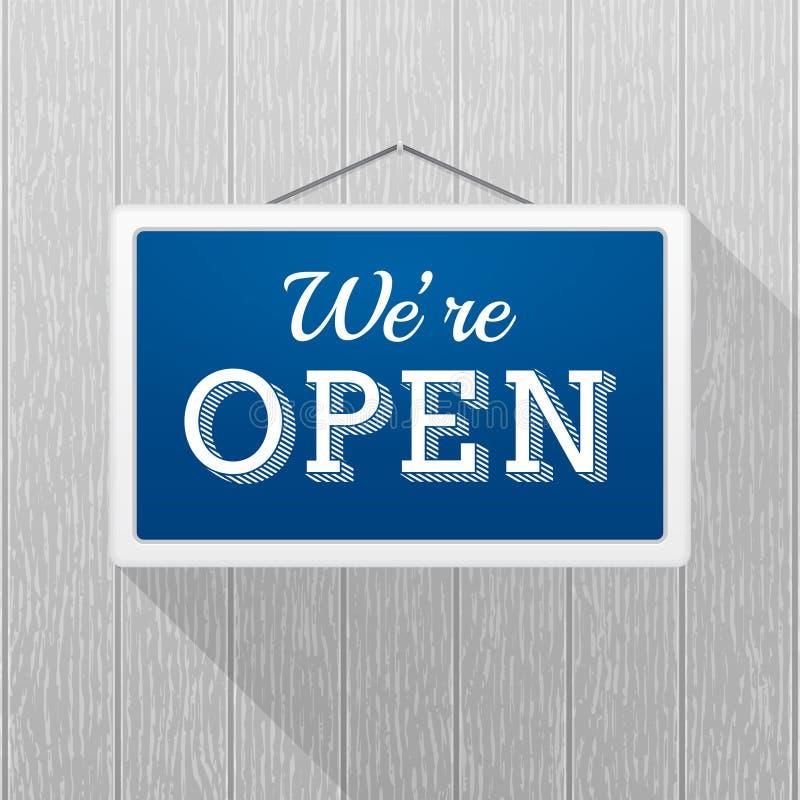 Sinal azul simples com ` do texto nós ` com referência ao ` aberto que pendura em uma parede de madeira cinzenta ilustração stock