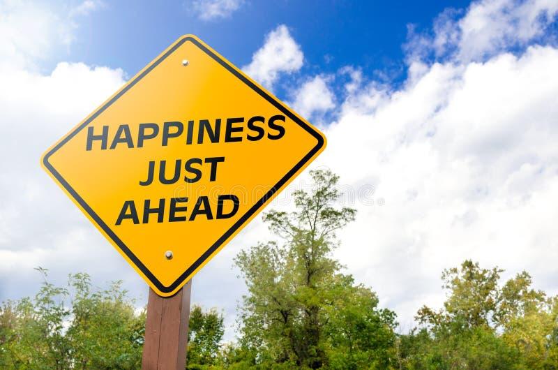 Sinal conceptual da felicidade apenas adiante imagem de stock