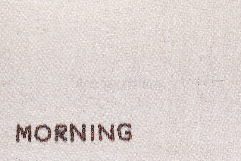 Sinal da letra da manhã dos feijões de café isolados na textura do linea, inferior esquerdo alinhado fotos de stock royalty free