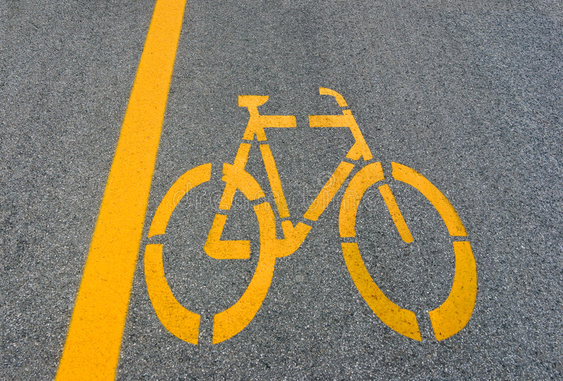 Sinal da pista de bicicleta na estrada fotografia de stock royalty free
