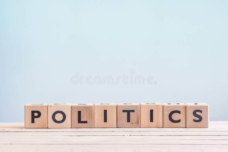Sinal da política feito de cubos de madeira foto de stock