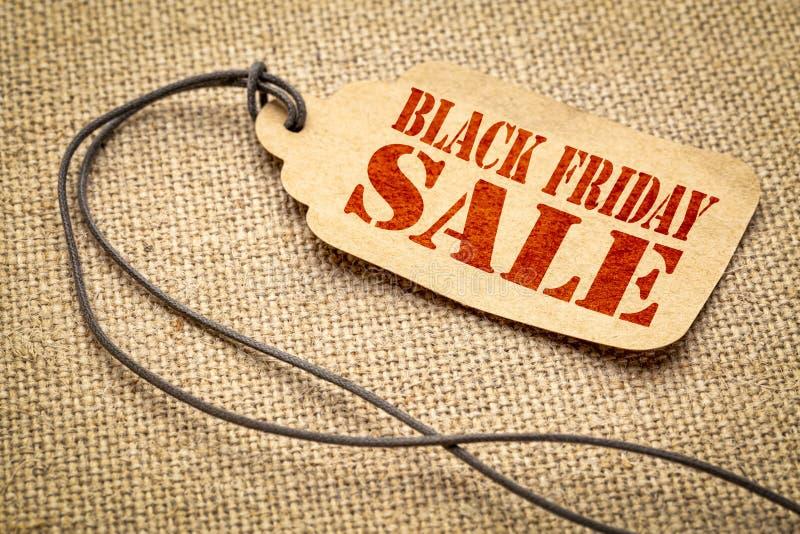 Sinal da venda de Black Friday no preço de papel imagens de stock royalty free