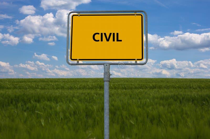 Sinal de estrada amarelo a palavra CIVIL é indicada O sinal está em um campo com fundo azul imagens de stock