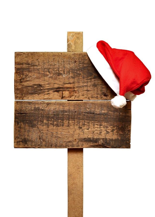 Sinal de estrada com chapéu de Santa imagens de stock royalty free