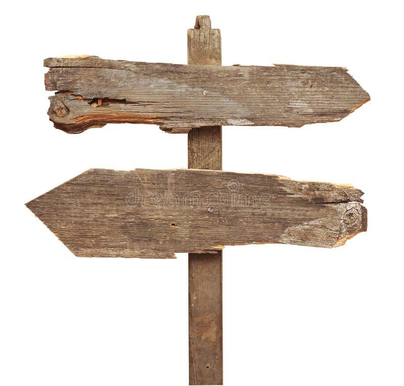 Sinal de estrada de madeira velho das setas fotografia de stock