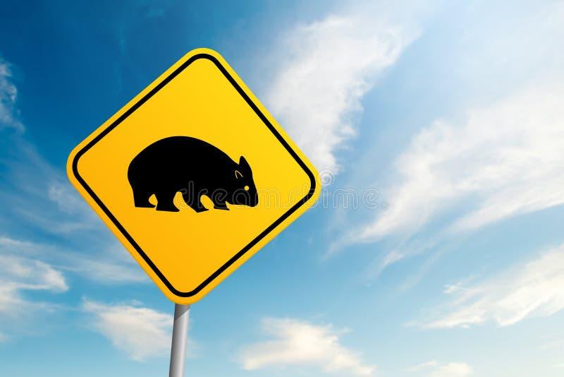 Sinal de estrada dos fascolomos dos animais selvagens de Autralian com o CCB do céu azul e da nuvem foto de stock royalty free