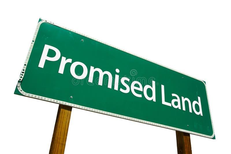Sinal de estrada prometido da terra isolado no branco. fotografia de stock