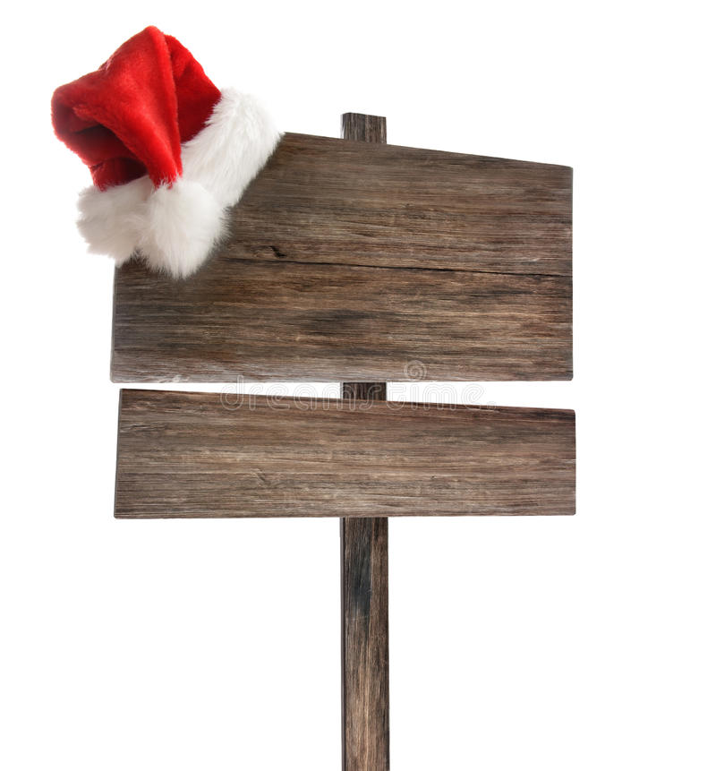 Sinal de madeira resistido com o chapéu de Santa no branco imagens de stock