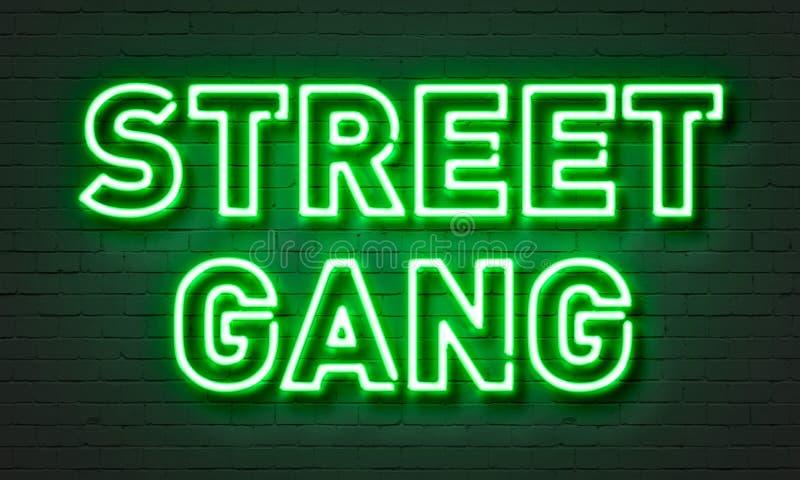 Sinal de néon do grupo da rua no fundo da parede de tijolo imagens de stock royalty free
