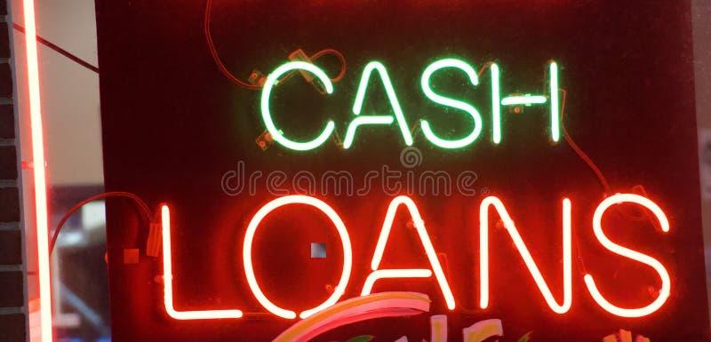 Sinal de néon de empréstimos de dinheiro fotografia de stock royalty free