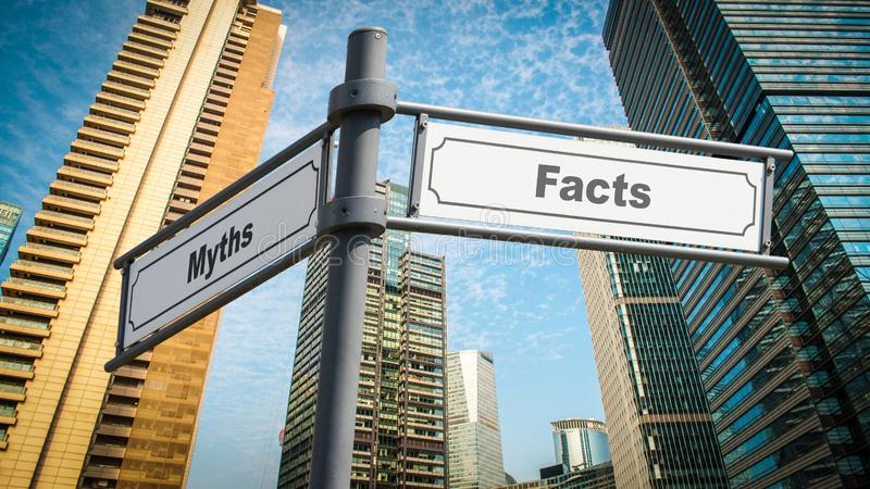Sinal de rua aos fatos contra mitos imagens de stock