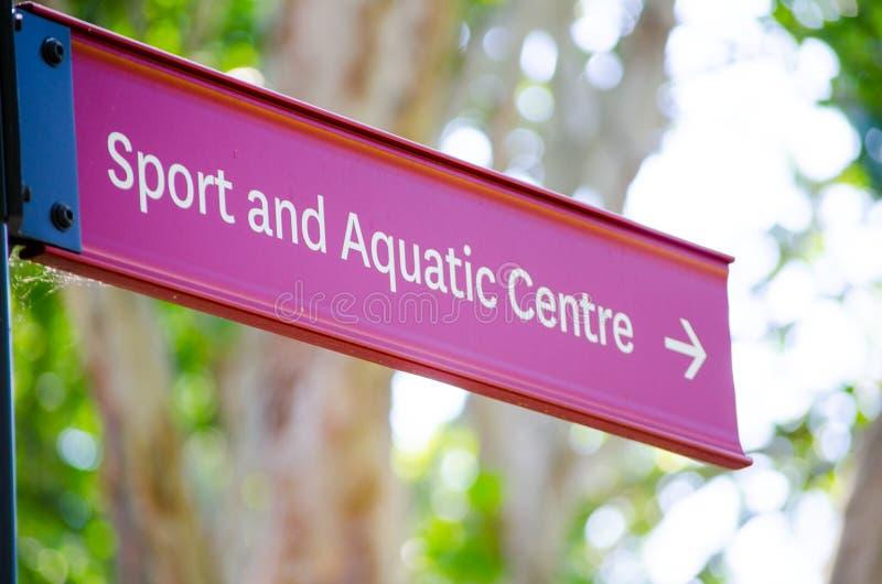 Sinal de sentido vermelho para o esporte e o centro aquático fotografia de stock royalty free