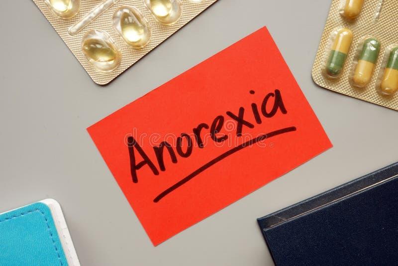 Sinal de texto que mostra as palavras manuscritas a Anorexia foto de stock